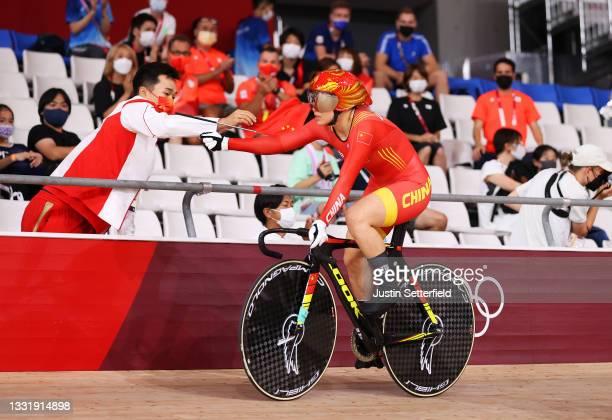 Shanju Bao of Team China celebrates winning the gold medal during the Women's team sprint finals, gold medal of the Track Cycling on day 10 of the...
