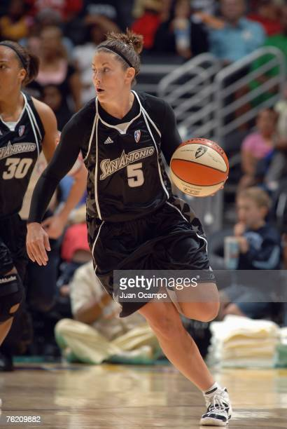 Shanna Crossley of the San Antonio Silver Stars moves the ball during the WNBA game with the Los Angeles Sparks on August 14 2007 at Staples Center...