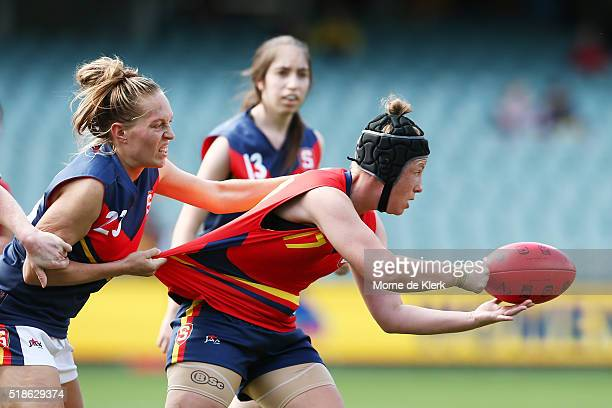 Shannen Solly of SA Blue tackles Rebekka McMahon of SA Red during the SANFL All Stars Women's Exhibition match at Adelaide Oval on April 2 2016 in...