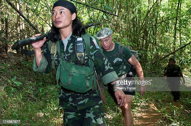 Shannon Allison a 48 years old dentist from Louisiana and a former US Army soldier with the Special Forces walks in the forest during a mission with...