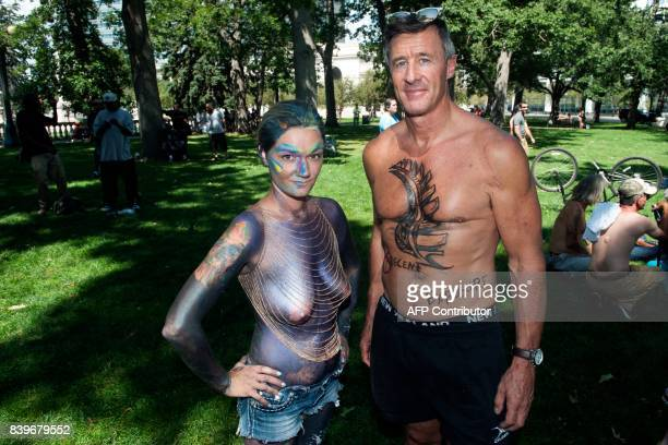 Shannon and Pete McKeown of Aurora Colorado pose for a portrait prior to marching in the 2017 GoTopless Day Parade on August 26 2017 in Denver...