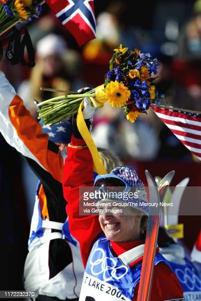 Shannon Bahrke, of Tahoe City, California and Kari Traa, of Norway, behind her at the flower ceremony after winning gold and silver respectively in...
