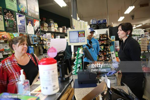 Shannon Blott talks to a customer who offered condolences on hearing about the death of Steve Shulman coowner of the Leschi Market and active...