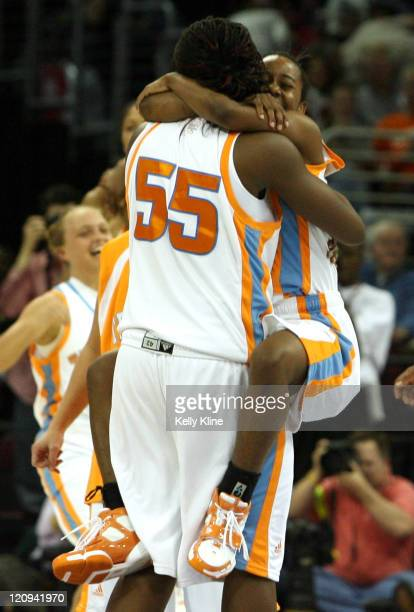 Shannon Bobbitt and Nicky Anosike celebrate during the semifinal of the NCAA Women's basketball tournament at Quicken Loans Arena in Cleveland Ohio...