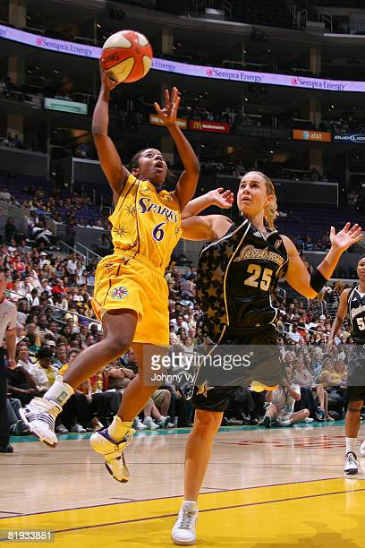 Shannon Bobbitt of the Los Angeles Sparks goes up for a shot against Becky Hammon of the San Antonio Silver Stars on July 14 2008 at Staples Center...