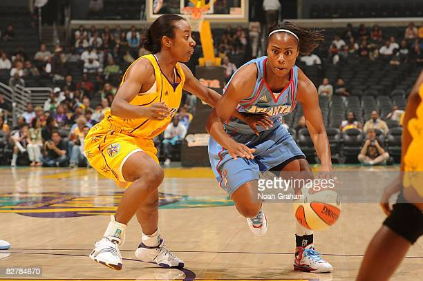 Shannon Bobbitt of the Los Angeles Sparks guards a drive to the basket from Ivory Latta of the Atlanta Dream on September 11, 2008 at Staples Center...