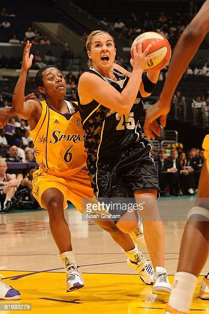 Shannon Bobbitt of the Los Angeles Sparks guards as Becky Hammon of the San Antonio Silver Stars drives the ball during the game at Staples Center...