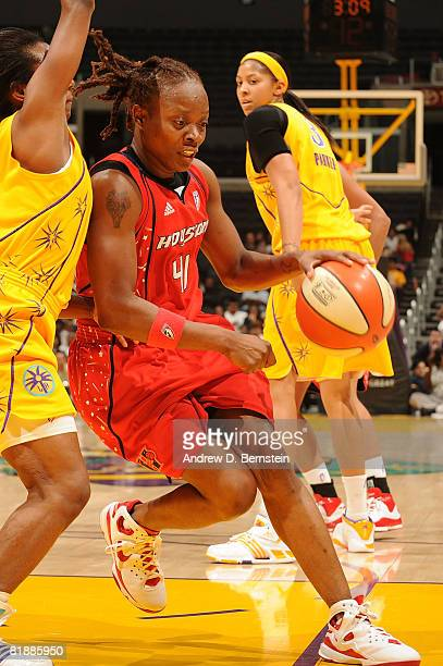 Shannon Bobbitt of the Los Angeles Sparks guards as Shannon Johnson of the Houston Comets drives the ball during the game at Staples Center July 9...