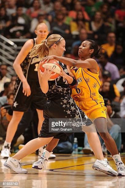 Shannon Bobbitt of the Los Angeles Sparks reaches for the ball during the game against Becky Hammon of the San Antonio Silver Stars at Staples Center...