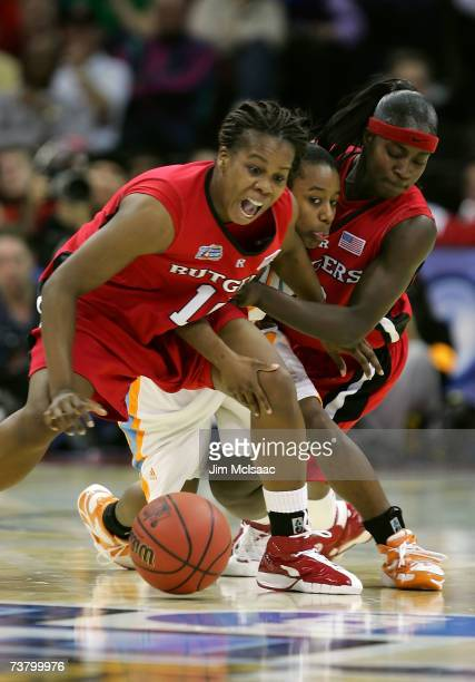 Shannon Bobbitt of the Tennessee Lady Volunteers fights for the loose ball against Epiphanny Prince and Matee Ajavon of the Rutgers Scarlet Knights...