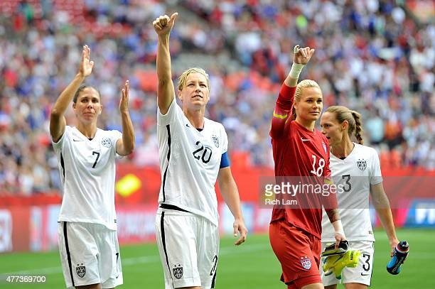 Shannon Boxx Abby Wambach Ashlyn Harris and Christie Rampone of the United States celebrate with teammates after the 10 victory against Nigeria in...