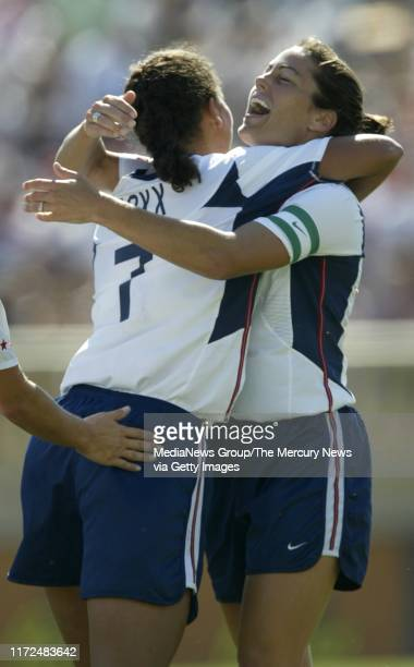 SIMON 9/7/2003 Shannon Boxx left gets a hug from Julie Foudy after Boxx scored the first goal of the game on an assist from Foudy 10 minutes into...