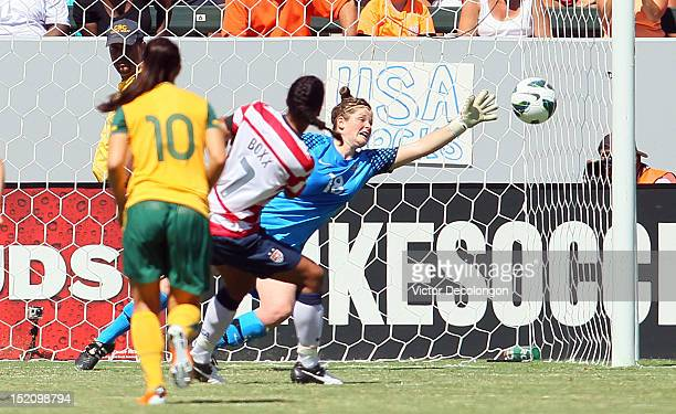 Shannon Boxx of the USA scores on a penalty kick in the second half against goalkeeper Brianna Davey of Australia during the international friendly...