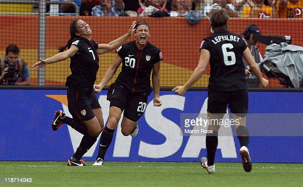 Shannon Boxx of USA celebrate their team opening goal during the FIFA Women's World Cup 2011 Quarter Final match between Brazil and USA at...
