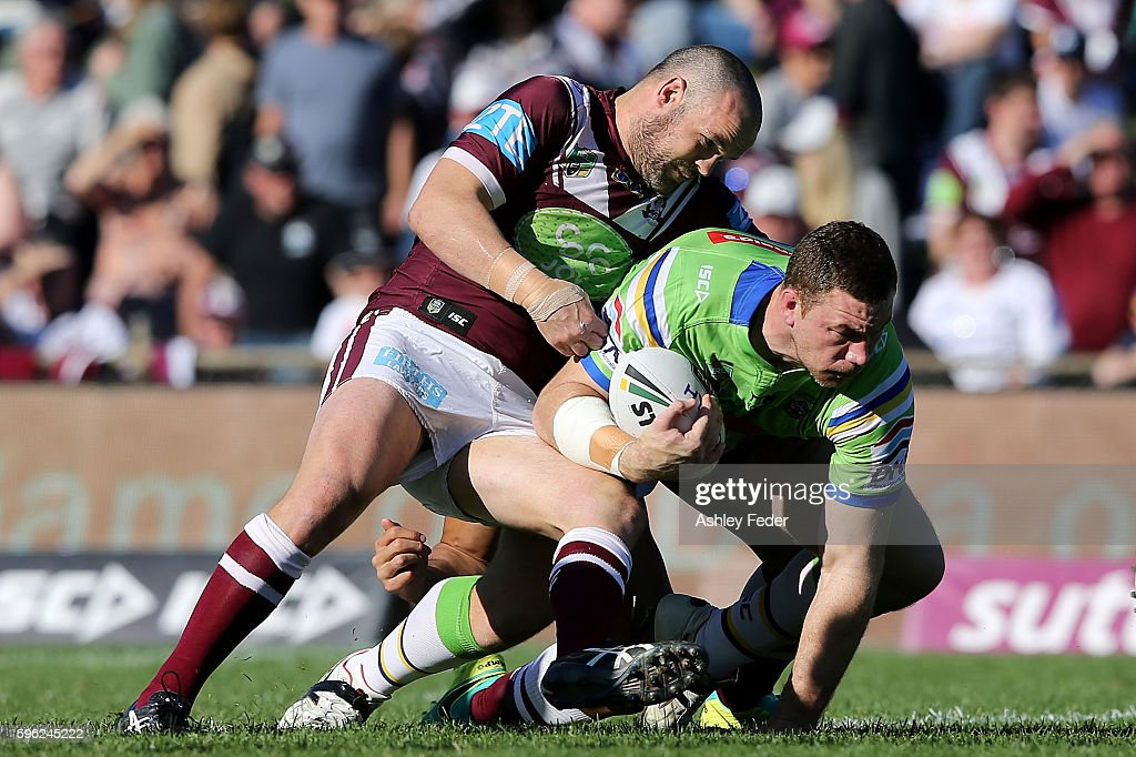 Shannon Boyd of the Raiders is tackled by Nate Myles of the Sea Eagles during the round 25 NRL match between the Manly Sea Eagles and the Canberra Raiders at Brookvale Oval on August 27, 2016 in Sydney, Australia.