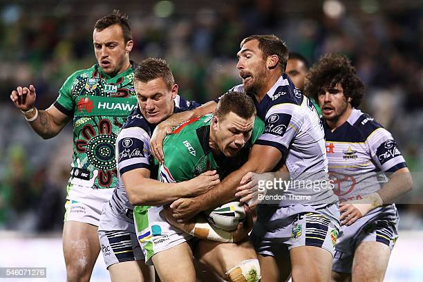 Shannon Boyd of the Raiders is tackled by the Cowboys defence during the round 18 NRL match between the Canberra Raiders and the North Queensland...