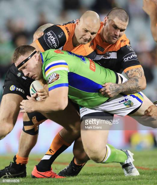 Mahe Fonua of the Tigers injures his arm during the round 15 NRL match between the Wests Tigers and the Canberra Raiders at Campbelltown Sports...
