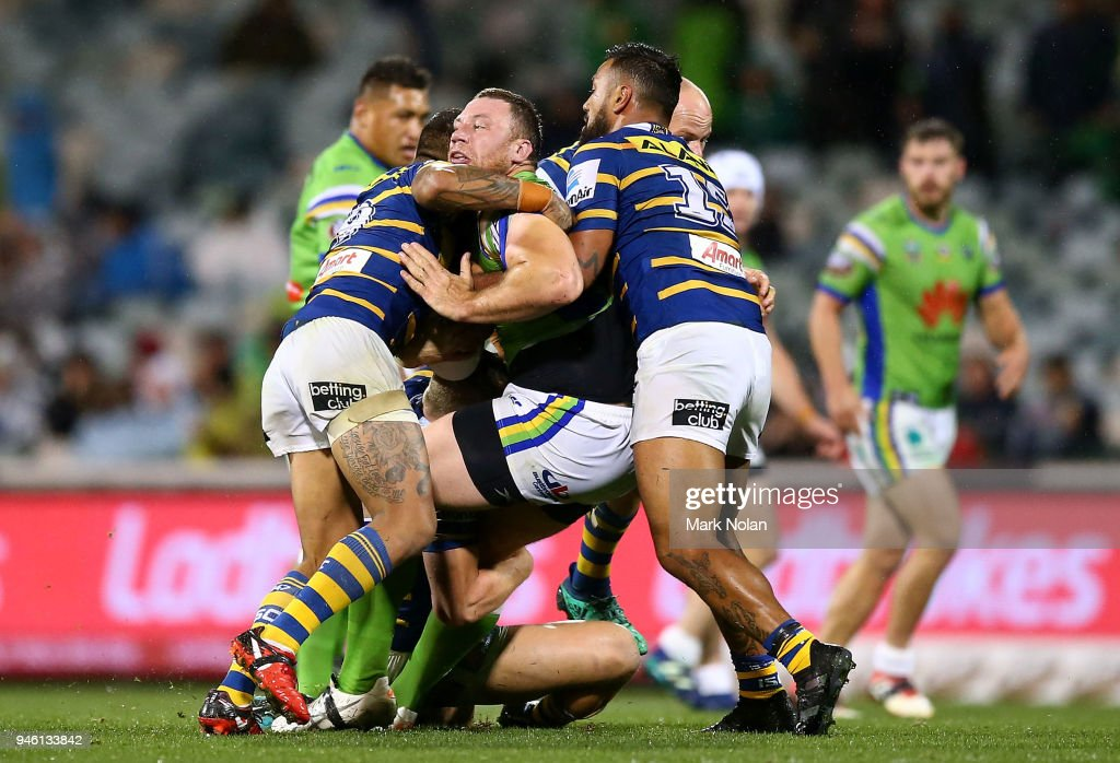 Shannon Boyd of the Raiders is tackled during the round six NRL match between the Canberra Raiders and the Parramatta Eels at GIO Stadium on April 14, 2018 in Canberra, Australia.