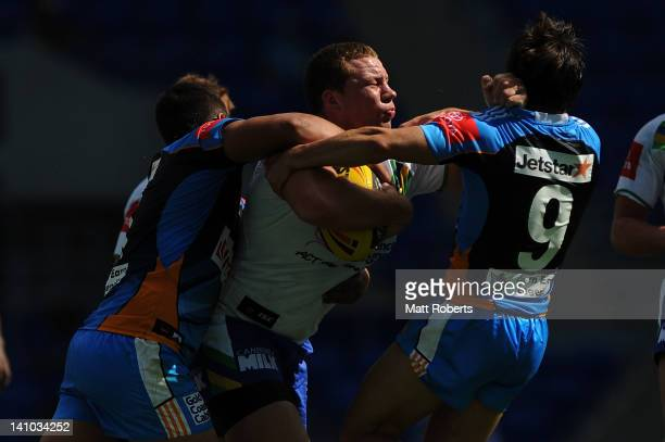 Shannon Boyd of the Raiders is tackled during the round two Toyota Cup match between the Gold Coast Titans and the Canberra Raiders at Skilled Park...