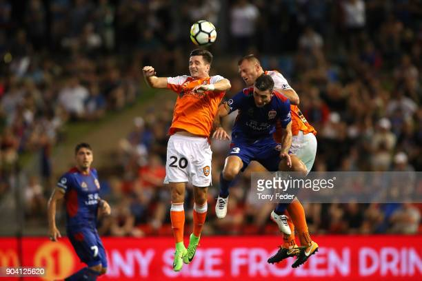 Shannon Brady of the Roar contests a header with Jason Hoffman of the Jets during the round 16 ALeague match between the Newcastle Jets and the...