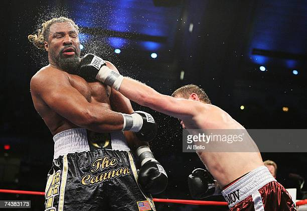 Shannon Briggs takes a punch from Sultan Ibragimov during their WBO Heavyweight Championship fight at Boardwalk Hall June 2 2007 in Atlantic City New...