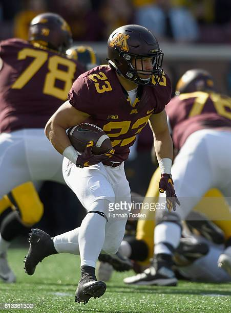 Shannon Brooks of Minnesota carries the ball against Iowa during the first quarter of the game on October 8 2016 at TCF Bank Stadium in Minneapolis...