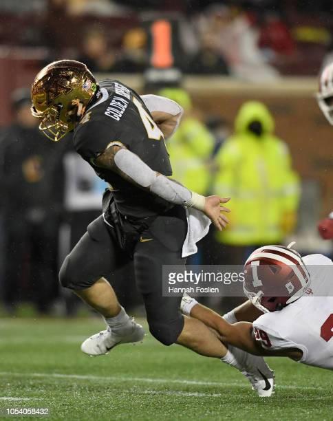 Shannon Brooks of the Minnesota Golden Gophers avoids a tackle by Khalil Bryant of the Indiana Hoosiers during the third quarter of the game on...
