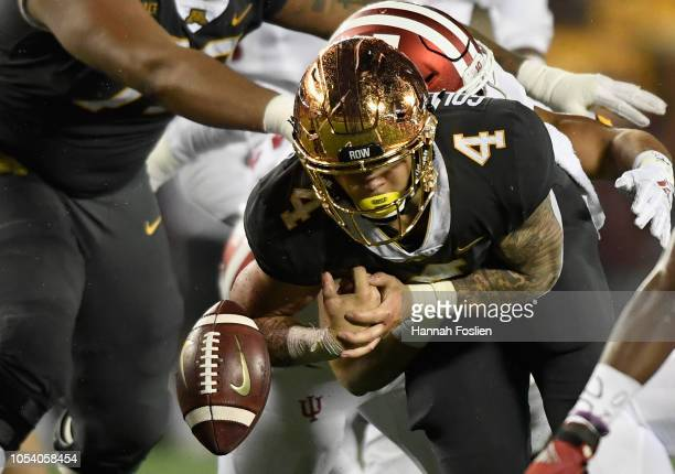 Shannon Brooks of the Minnesota Golden Gophers fumbles the ball against the Indiana Hoosiers during the third quarter of the game on October 26 2018...