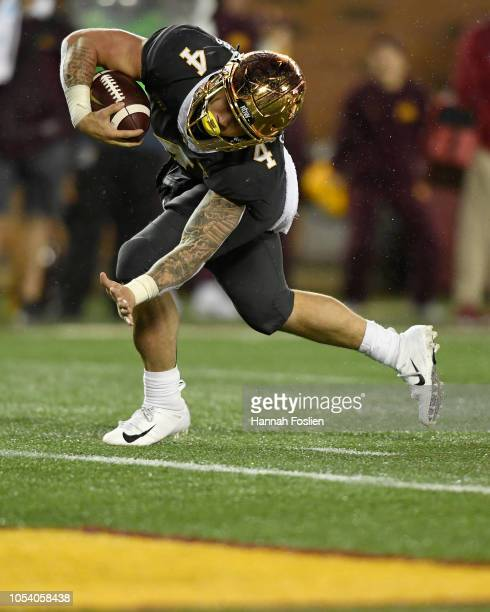 Shannon Brooks of the Minnesota Golden Gophers scores a touchdown against the Indiana Hoosiers during the third quarter of the game on October 26...
