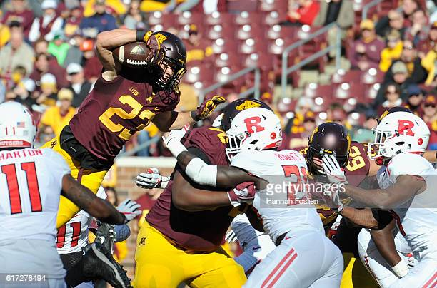 Shannon Brooks of the Minnesota Golden Gophers scores a touchdown against the Rutgers Scarlet Knights during the first quarter of the game on October...