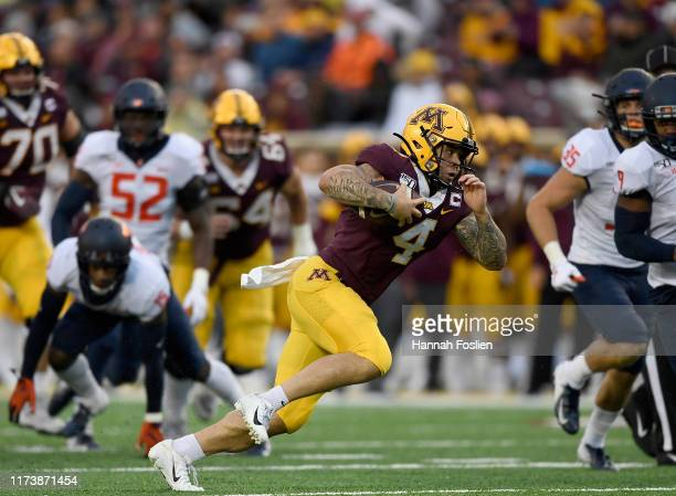 Shannon Brooks of the Minnesota Gophers carries the ball against the Illinois Fighting Illini during the third quarter of the game at TCF Bank...