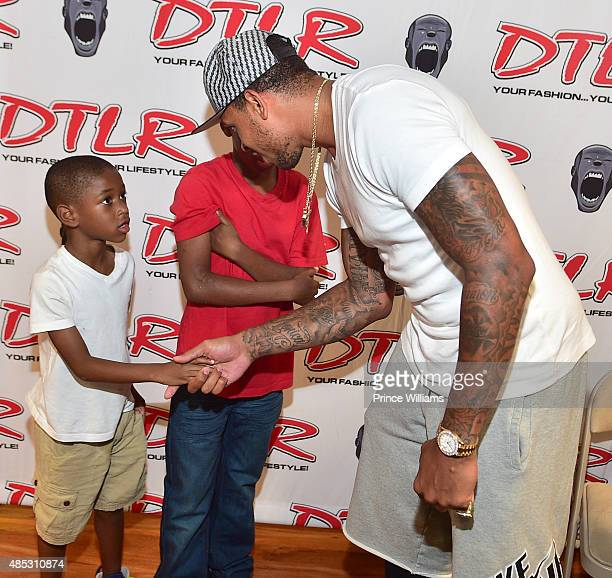 Shannon Brown attends Monica's meet and greet showcasing her single 'Just Right for Me' at DTLR at Cramp Creek on August 26 2015 in Atlanta Georgia