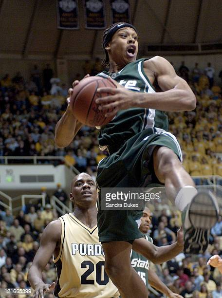 Shannon Brown grabs a second half rebound in front of Kenneth Lowe in Purdue's 76-70 win.