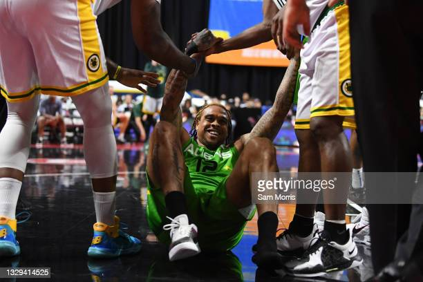 Shannon Brown of Aliens is helped up by Aliens players during week two of the BIG3 at the Orleans Arena on July 18, 2021 in Las Vegas, Nevada.