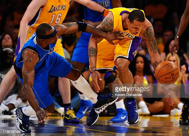 Shannon Brown of the Los Angeles Lakers goes after the ball as Jason Terry of the Dallas Mavericks goes down next to him in the first quarter in Game...