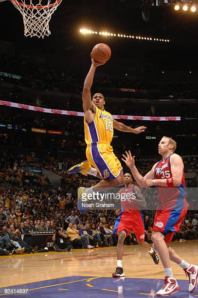 Shannon Brown of the Los Angeles Lakers goes up for a dunk against Chris Kaman of the Los Angeles Clippers in the season opener at Staples Center on...