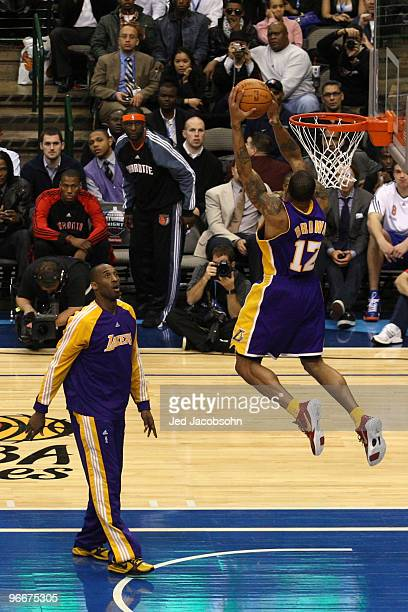 Shannon Brown of the Los Angeles Lakers goes up for a dunk with the help of teammate Kobe Bryant during the Sprite Slam Dunk Contest on AllStar...
