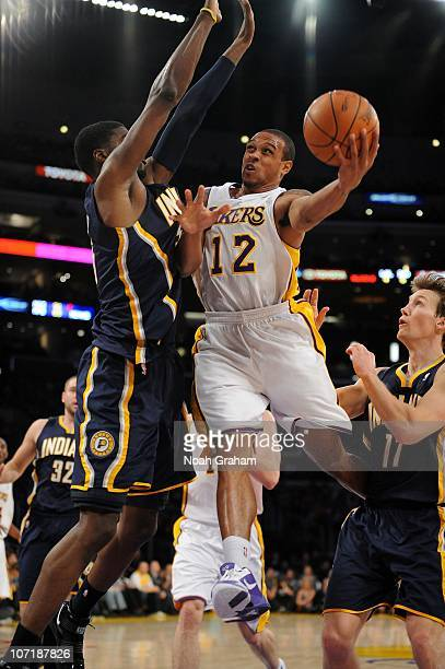 Shannon Brown of the Los Angeles Lakers goes up for a shot against the Indiana Pacers at Staples Center on November 28 2010 in Los Angeles California...