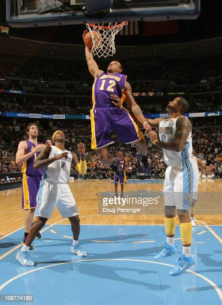 Shannon Brown of the Los Angeles Lakers grabs a rebound and dunks the ball between Al Harrington and Gary Forbes of the Denver Nuggets at the Pepsi...