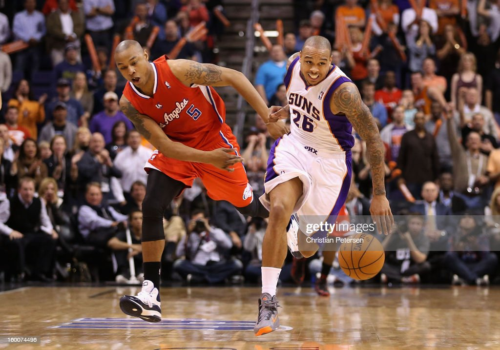 Shannon Brown #26 of the Phoenix Suns is fouled by Caron Butler #5 of the Los Angeles Clippers as he moves the ball upcourt during the NBA game at US Airways Center on January 24, 2013 in Phoenix, Arizona. The Suns defeated the Clippers 93-88.
