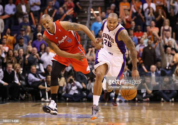 Shannon Brown of the Phoenix Suns is fouled by Caron Butler of the Los Angeles Clippers as he moves the ball upcourt during the NBA game at US...