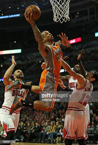 Shannon Brown of the Phoenix Suns puts up a shot over Carlos Boozer Loul Deng and Kirk Hinrich of the Chicago Bulls at the United Center on January...