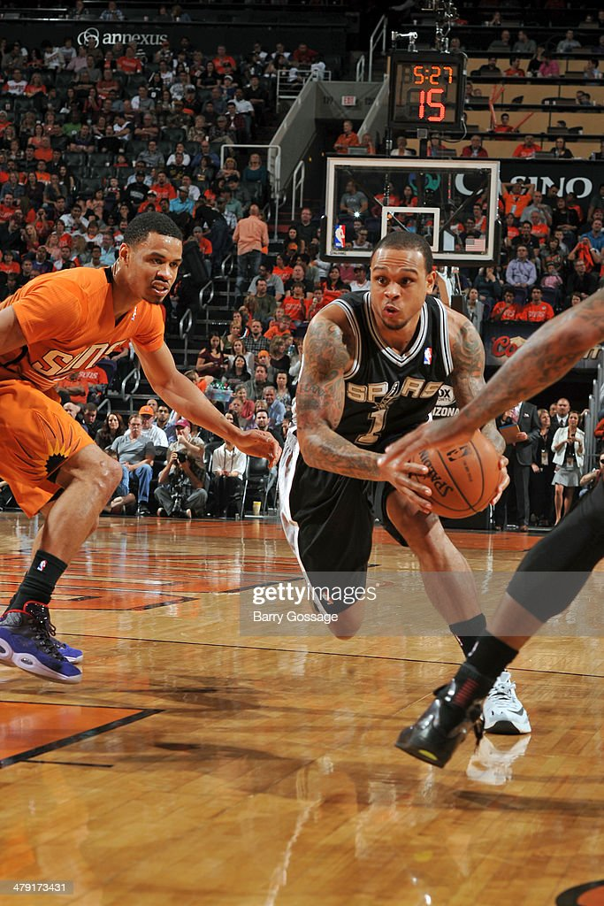 Shannon Brown #1 of the San Antonio Spurs drives to the basket against the Phoenix Suns on February 21, 2014 at U.S. Airways Center in Phoenix, Arizona.
