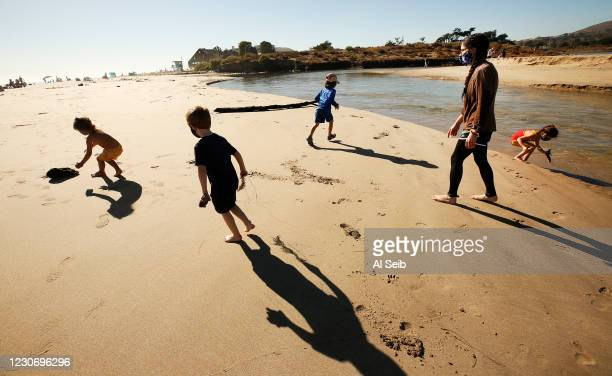Shannon Burns, right, who is a mentor to four kindergarten student explorers from Everwild LA Westside as they hold class at Malibu Lagoon State...