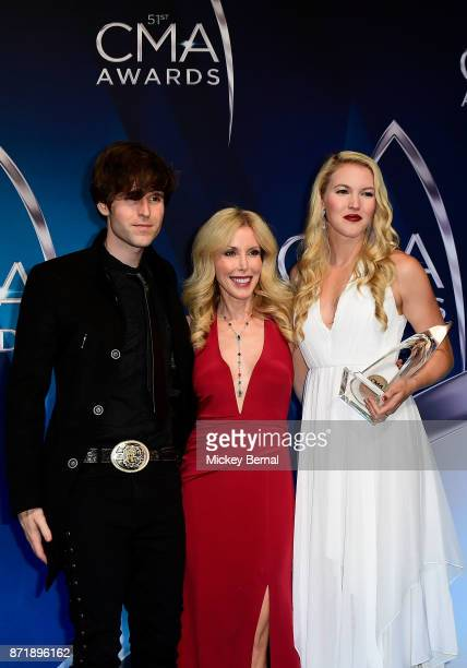Shannon Campbell Kimberly Woolen and Ashley Campbell pose in the press room during the 51st annual CMA Awards at the Bridgestone Arena on November 8...