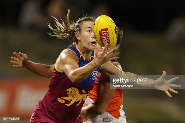 Shannon Campbell of the Lions is tackled by Renee Forth of the Giants during the round seven AFLW match between the Greater Western Sydney Giants and...