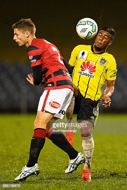 Shannon Cole of the Wanderers and Roly Bonevacia of the Phoenix colide during the FFA Cup Round of 32 match between the Western Sydney Wanderers and...