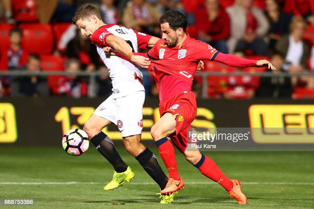 Shannon Cole of the Wanderers and Sergio Cirio of Adelaide contest for the ball during the round 27 ALeague match between Adelaide United and the...