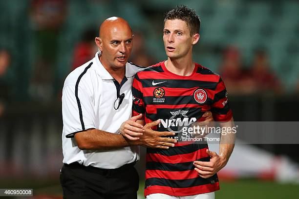 Shannon Cole of the Wanderers is directed by security away from RBB fans following the round 14 ALeague match between the Western Sydney Wanderers...