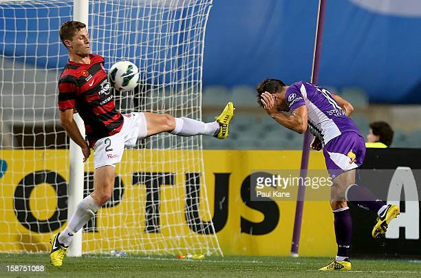 Shannon Cole of the Wanderers saves a shot on goal by Liam Miller of the Glory during the round 13 ALeague match between the Perth Glory and the...